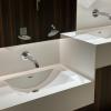 Project wereldhave toiletruimtes - HI-MACS maatwerk wastafels kinderen - Solid Surface wasbak Incollato Wave