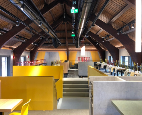 CORA Projects - McDonalds CNSTRCT Corian trap Imperial Yellow 2.jpeg