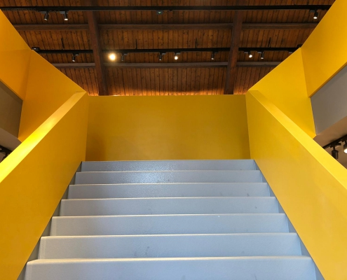 CORA Projects - McDonalds CNSTRCT Corian trap Imperial Yellow