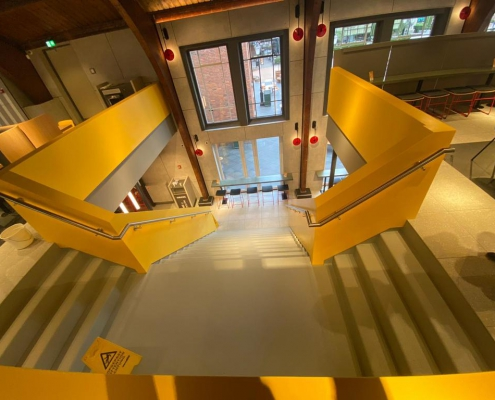 CORA Projects - McDonalds CNSTRCT Corian trap Imperial Yellow 7