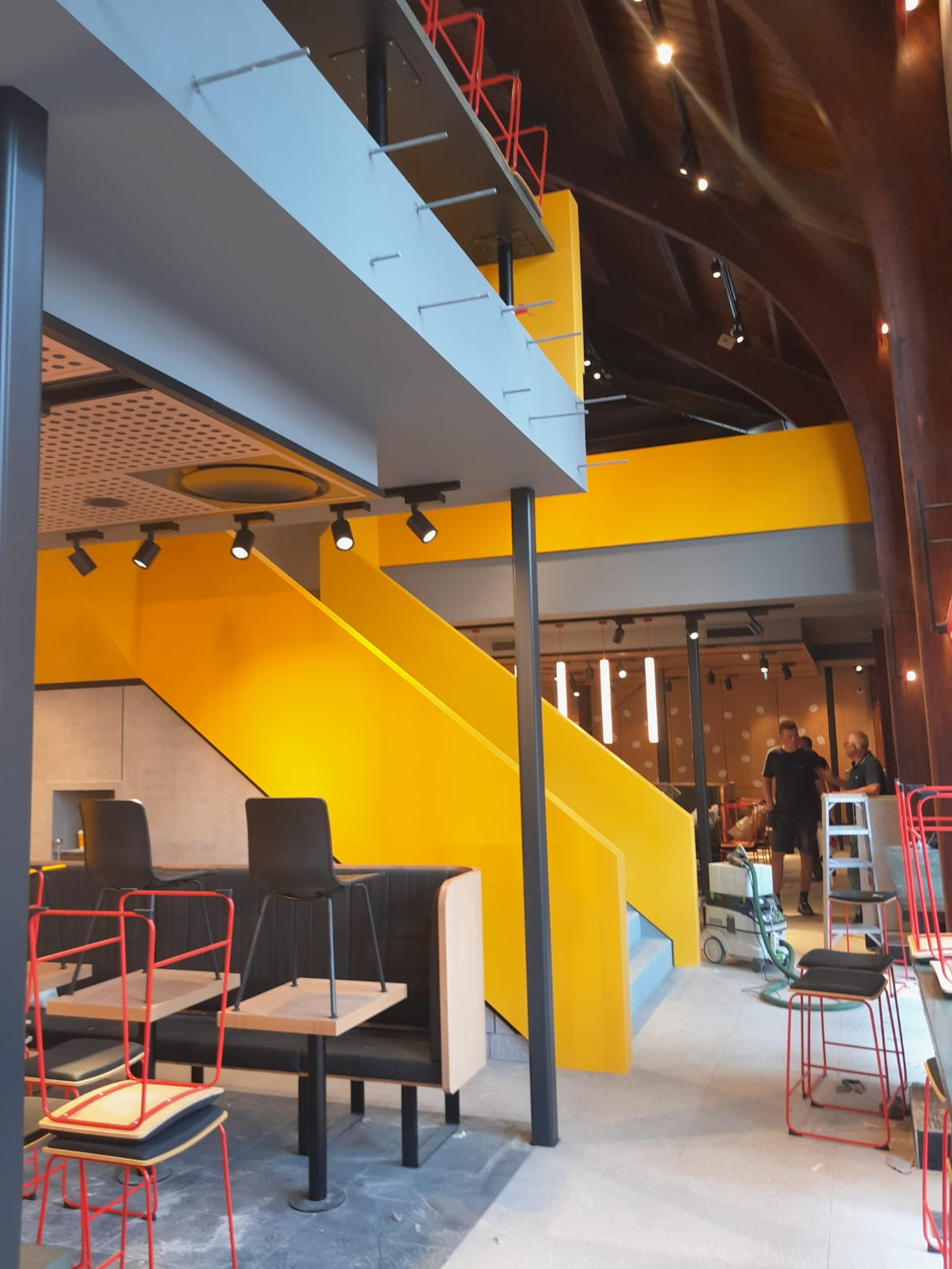 CORA Projects - McDonalds CNSTRCT Corian trap Imperial Yellow3
