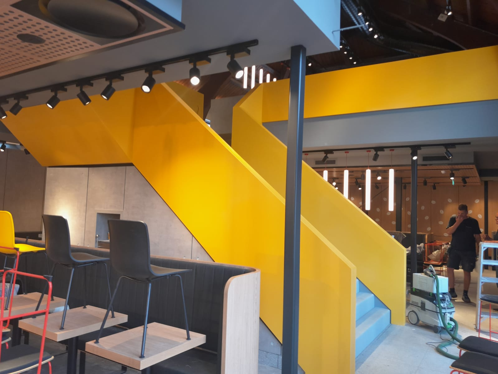 CORA Projects - McDonalds CNSTRCT Corian trap Imperial Yellow4